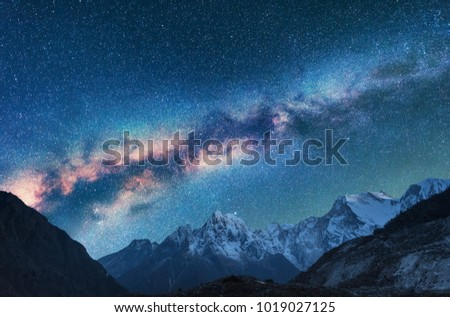 Space. Milky Way and mountains. Fantastic view with mountains and starry sky at night in Nepal. Mountain valley and sky with stars. Beautiful Himalayas. Night landscape with bright milky way. Galaxy #1019027125