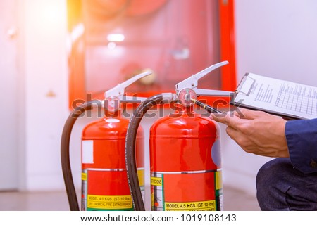 Engineer checking Industrial fire control system,Fire Alarm controller, Fire notifier, Anti fire.System ready In the event of a fire. #1019108143