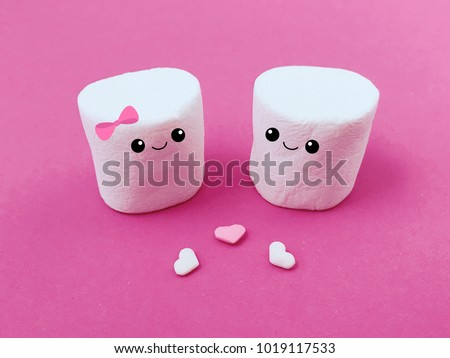 Marshmallows with eyes and smiles. Funny face. Cute cartoon character. Hearts. Happy Valentines Day Love sign symbol. Minimal flat lay design. Marshmallow couple set. Sweet food. Pink background.