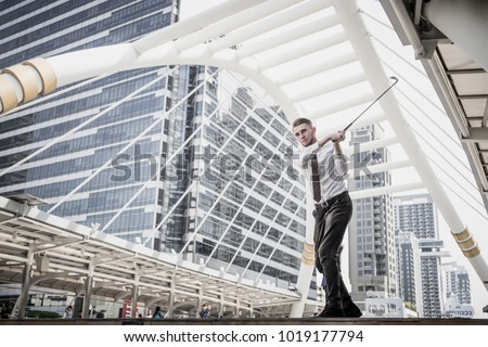 Portrait of Businessman playing golf with cityscape on the background. Business leisure concept. #1019177794