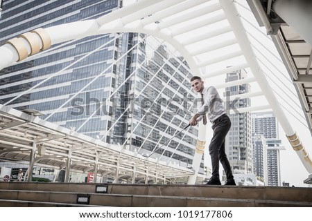 Portrait of Businessman playing golf with cityscape on the background. Business leisure concept. #1019177806