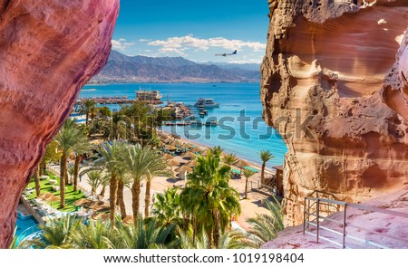 Central beach and marina in Eilat - famous resort and recreation city in Israel.This serene location is a very popular tropical gateway for Israeli and European tourists.  #1019198404