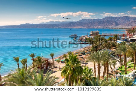 Central beach and marina in Eilat - famous resort and recreation city in Israel. This serene location is a very popular tropical getaway for Israeli and European tourists.  #1019199835