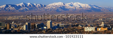 This is Utah's State Capitol with the Great Salt Lake and snow capped Wasatch Mountains in morning light.