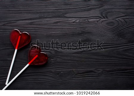 Two red Candy hearts on black wooden background. Minimal love concept. Romantic Style.  Creative for colorful greeting card with copy space. #1019242066