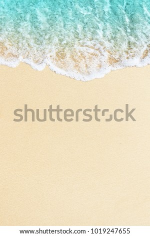 Blue ocean wave on sandy beach Royalty-Free Stock Photo #1019247655