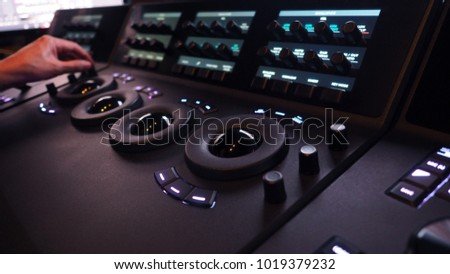 Telecine controller machine for editing or adjusting color on digital video movie or film in the post production stage.