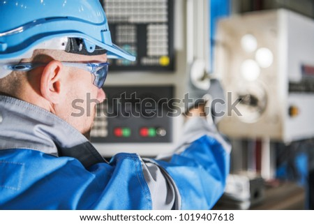 Computer Numerical Control Lathe Machine Operator. CNC Caucasian Technician.MEtworking Industry Equipment. #1019407618