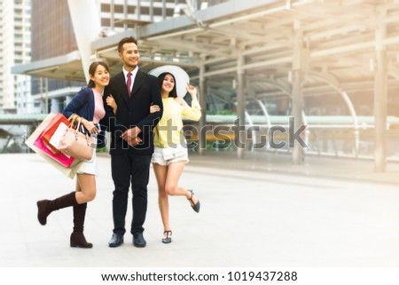 Beautiful asian girl and handsome man with packages after shopping A picture of a group of happy friends shopping in the city.They walking around the city after shopping. good mood.shopping concept. #1019437288