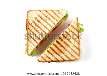 Sandwich with ham, cheese, tomatoes, lettuce, and toasted bread. Top view isolated on white background. #1019452438