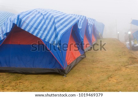 tourist tent in mist and fog. Travel tent in the morning with fog. #1019469379