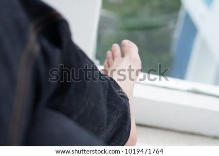 legs wear deep blue raw jean denim relax lay on the bed #1019471764