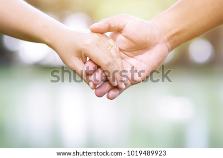 Woman and man holding hands, Happy couple love in the garden. concept couple lover valentine day. #1019489923