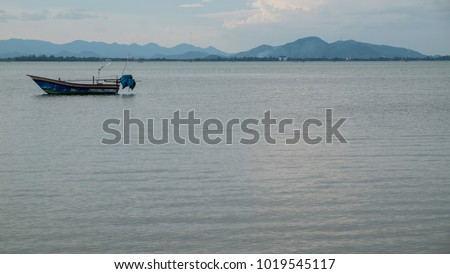 Small fishing boat in the sea. #1019545117