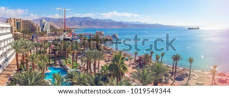 Central public beach and marina in Eilat - famous resort and recreation city in Israel. This serene location is a very popular tropical getaway for Israeli and European tourists   #1019549344
