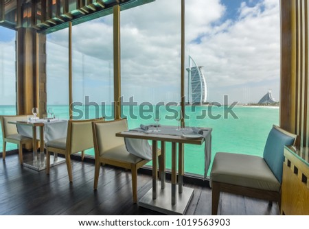 Dubai, United Arab Emirates - January 17, 2018: Interior of the restaurant Pierchic with a beautiful view of the Burj Al Arab Hotel. #1019563903