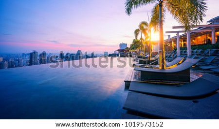 Cityscape of Singapore city with morning sunrise sky Royalty-Free Stock Photo #1019573152