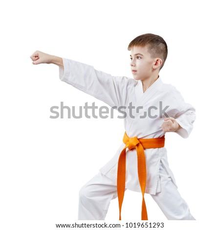 In karategi, the boy sportsman strikes with a hand #1019651293