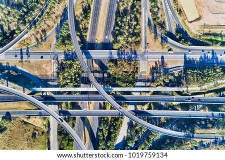 Aerial top down view on massive multi-level interchange on Sydney's Motorway 4 and Motorway 7 on a sunny summer day with light traffic #1019759134