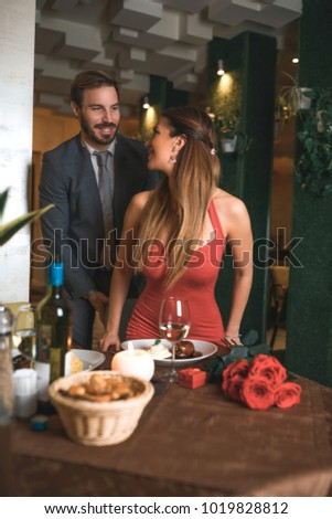 It's very important that you be a gentleman. Beautiful couple in the restaurant at valentines evening. #1019828812