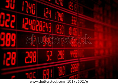 Display of red electronic board of stock market quotes. down trend or recession concept