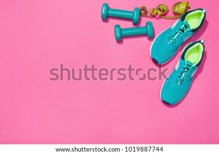 Fitness accessories, healthy and active lifestyles concept background with copy space for text. Products with vibrant, punchy pastel colours and frame composition. Image taken from above, top view. #1019887744
