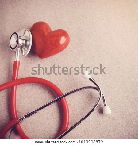 red heart with stethoscope, heart health,  health insurance concept, world health day #1019908879