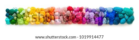 Colored balls of yarn. View from above. Rainbow colors. All colors. Yarn for knitting. Skeins of yarn. #1019914477