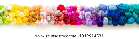 Colored balls of yarn. View from above. Rainbow colors. All colors. Yarn for knitting. Skeins of yarn. #1019914531