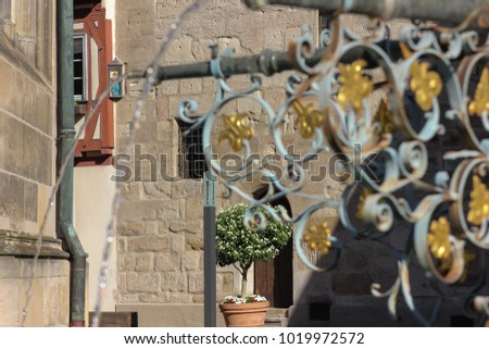 historical fountain details ornaments and objects in schwaebisch gmuend south germany city on a sunny summer day #1019972572