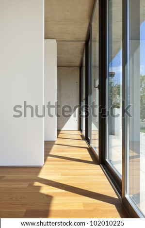 modern concrete house with hardwood floor, large window #102010225