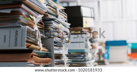 Stacks of paperwork and files in the office: work overload, files management and administration concept #1020181933