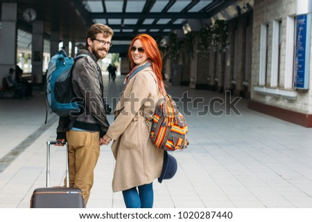 Real view of amorous hipster couple walking down station and chatting outdoors. Holyday and weekend concept #1020287440