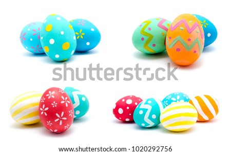 Collection of photos perfect colorful handmade easter eggs isolated on a white Royalty-Free Stock Photo #1020292756