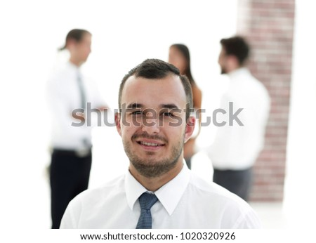 portrait of successful businessman on blurred background #1020320926