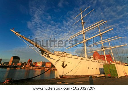 The Gorch Fock tall ship at sunrise, harbor of Stralsund, Germany. Photo taken in Stralsund, Mecklenburg-Vorpommern, Germany, July 2017 #1020329209