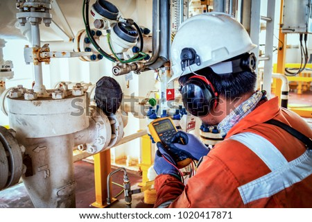 Technician,Instrument technician on the job calibrate or function check on instrument device or level transmitter in oil and gas platform offshore. #1020417871