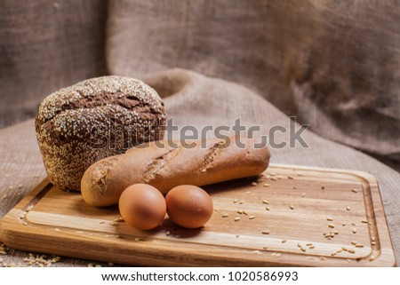 loaf of bread on a wooden board #1020586993