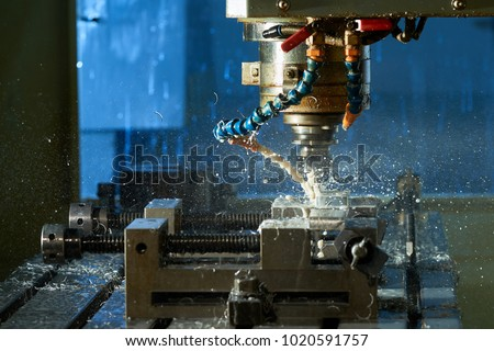 Metalworking CNC milling machine. Cutting metal modern processing technology.Milling metalworking process. Industrial high precision CNC metal machining by vertical mill.   #1020591757