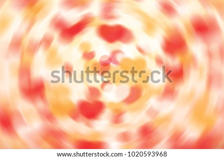 Valentine's Day background radial abstract heart-shaped bokeh lights effect with strong vivid colors, red, orange, yellow, smooth circular swooshes on white canvas surface