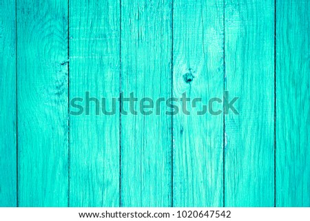 Painted pastel turquoise wood surface, with an abstract expressive vertical line texture. Pastel background for design #1020647542