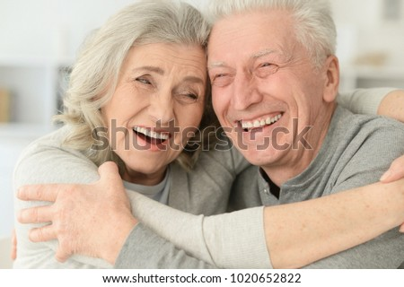 happy senior couple laughing  at home #1020652822