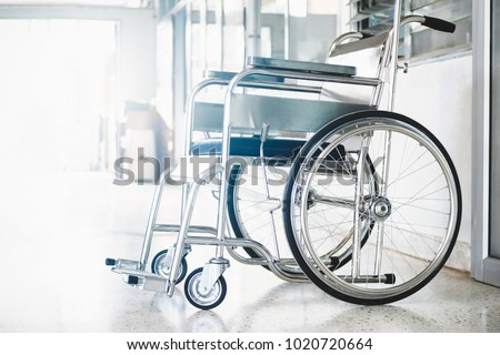 Wheelchairs in the hospital ,Wheelchairs waiting for patient services. with light copy space on left area Royalty-Free Stock Photo #1020720664