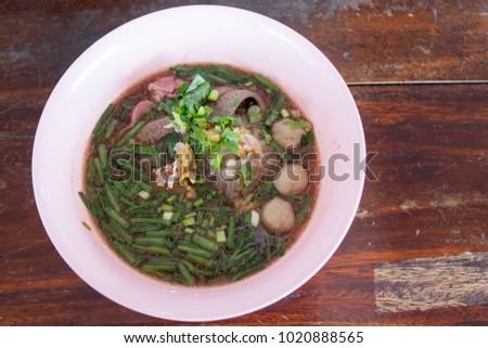 thai noodle in a pork soup #1020888565