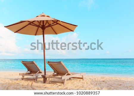 Two beach chairs on tropical vacation #1020889357