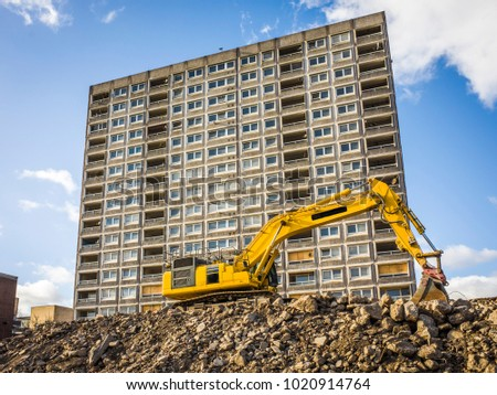 Early phase of urban housing construction site showing demolition of old council flats in London Royalty-Free Stock Photo #1020914764