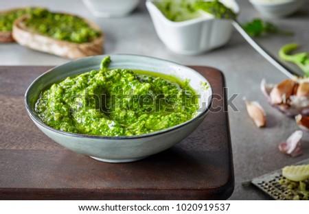 bowl of basil pesto, selective focus #1020919537