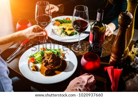 Couple having romantic dinner in a restaurant in rays of the sun #1020937660