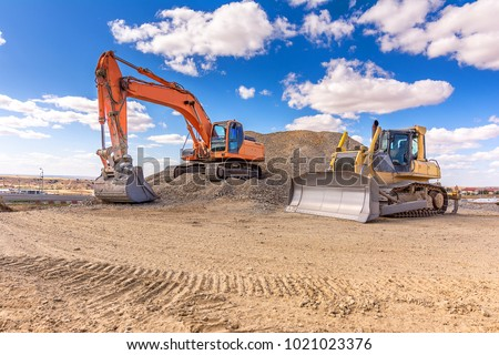 Group of excavator working on a construction site Royalty-Free Stock Photo #1021023376