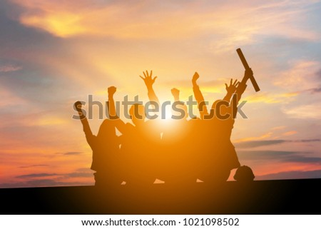 Silhouette of Engineer Business People Celebration Success Happiness Team at Sunset Evening Sky Background, with clipping path.